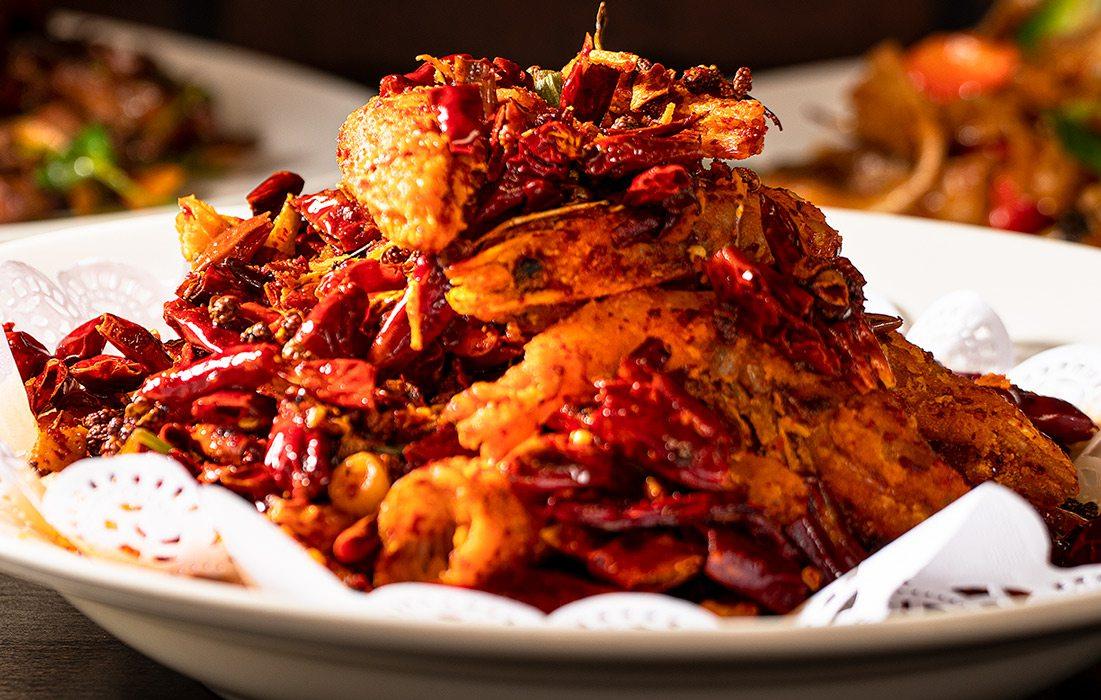 Szechuan Shrimp on white doiley on white plates