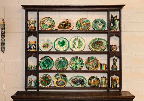 brown wooden chest with rows of green, ornate plates