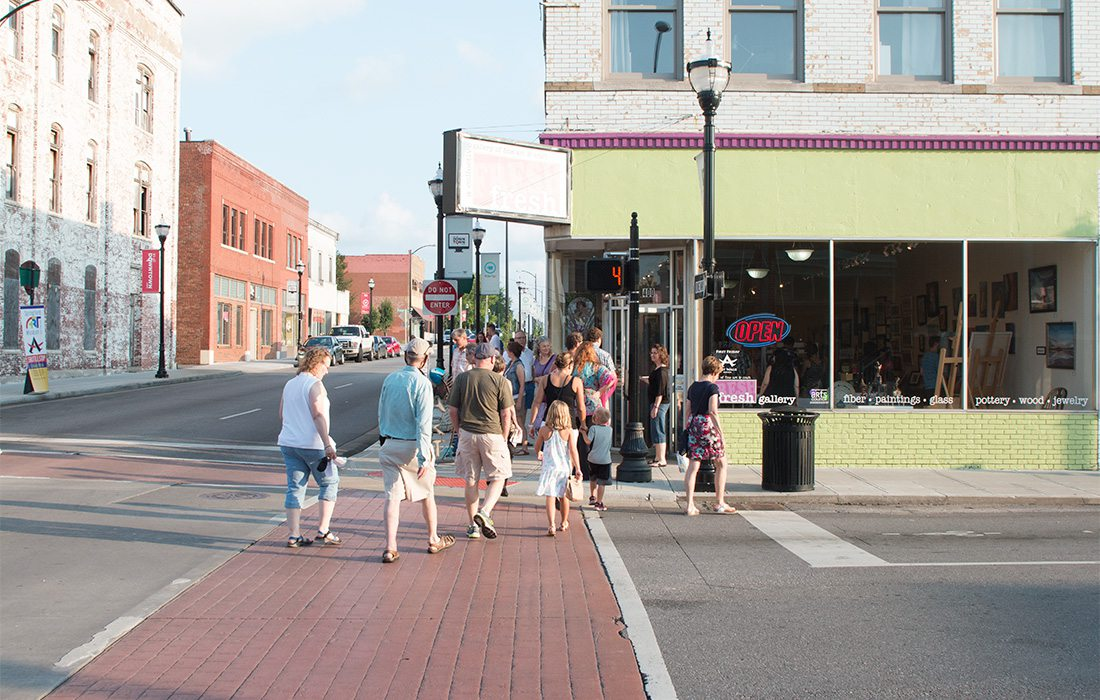 people walking in downtown springfield during art walk