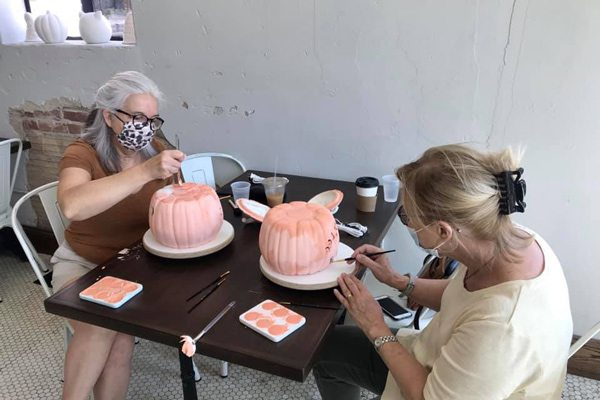 Women paint pottery at Artistree Pottery in Rountree Springfield MO