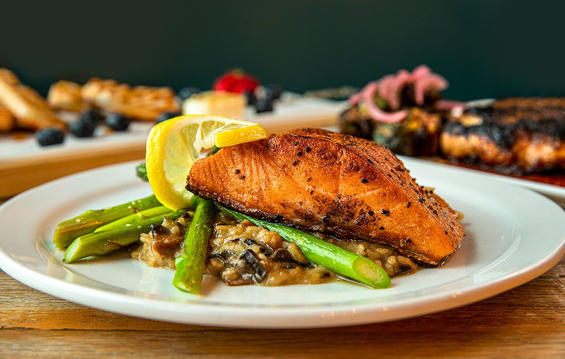 Salmon filet with mushroom and red pepper risotto
