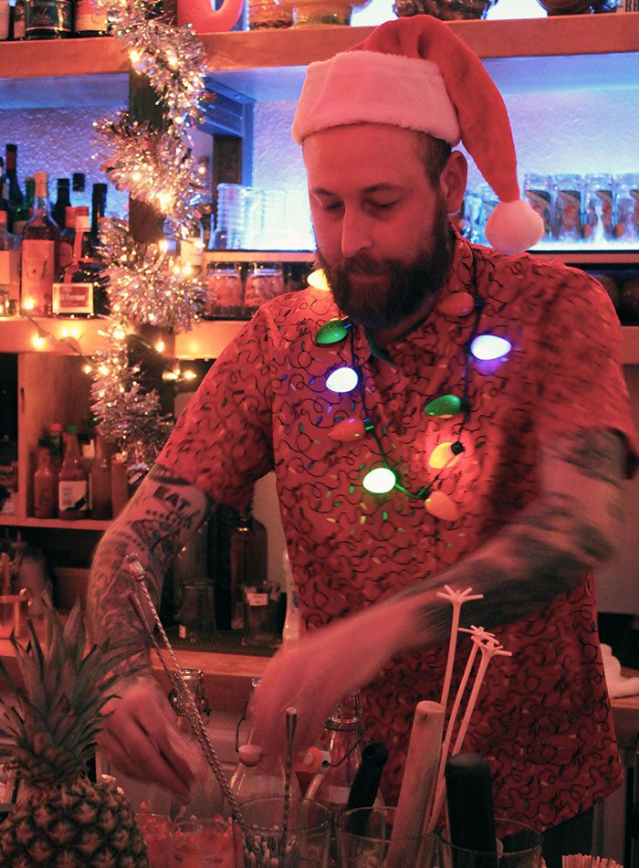 bartender making a drink at The Golden Girl Rum Club