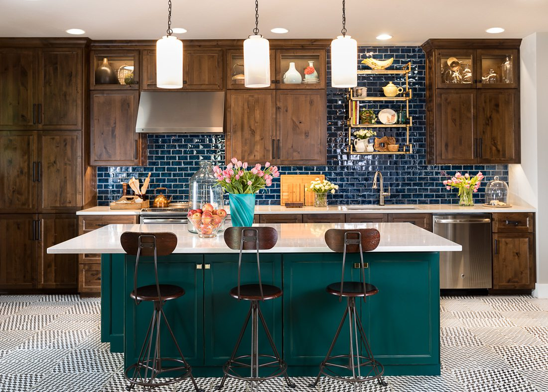 Kitchen with teal cabinets and blue tile.