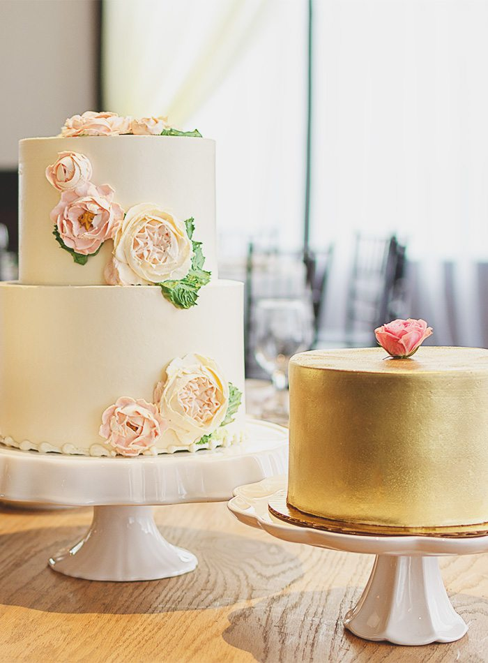 a white and a gold wedding cake