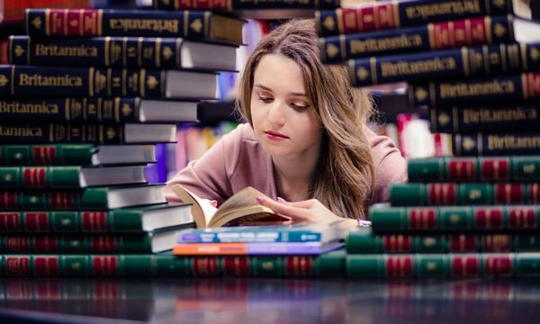 College Student Surrounded by Books