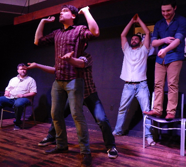 five people participating in improvised comedy