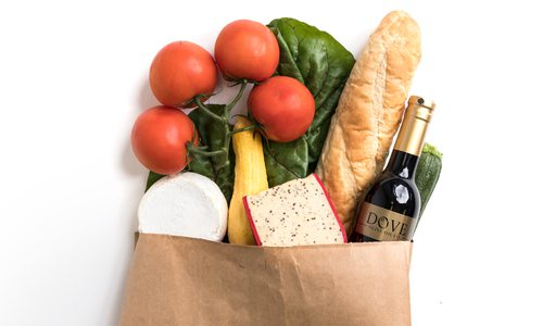 Paper grocery bag overflowing with produce