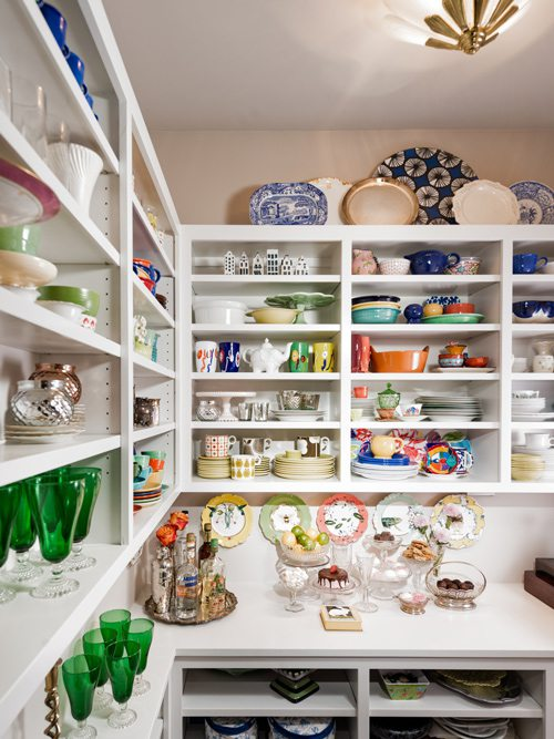 Colorful dish pantry.