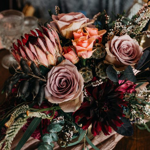 dark colored flowers for a wedding