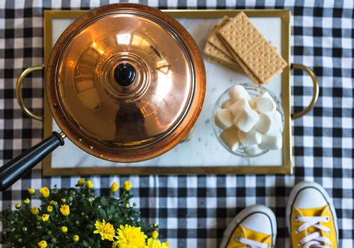 fondue and a checkered floors with yellow converse shoes