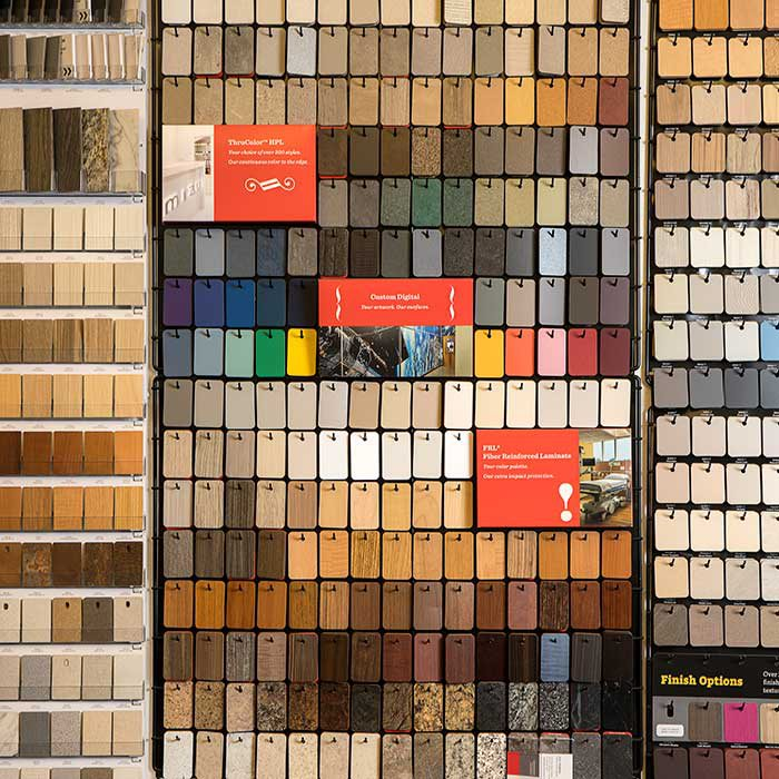 slabs of materials of different colors, textures, and type line the wall