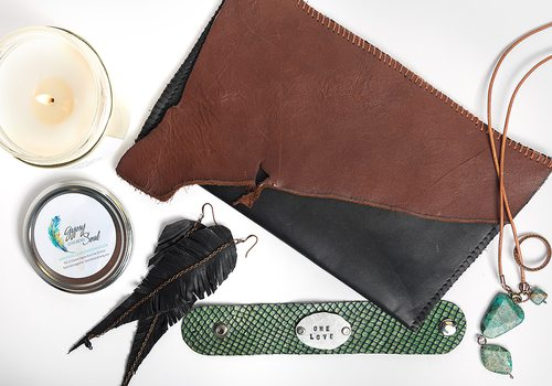 leather accessories and a candle