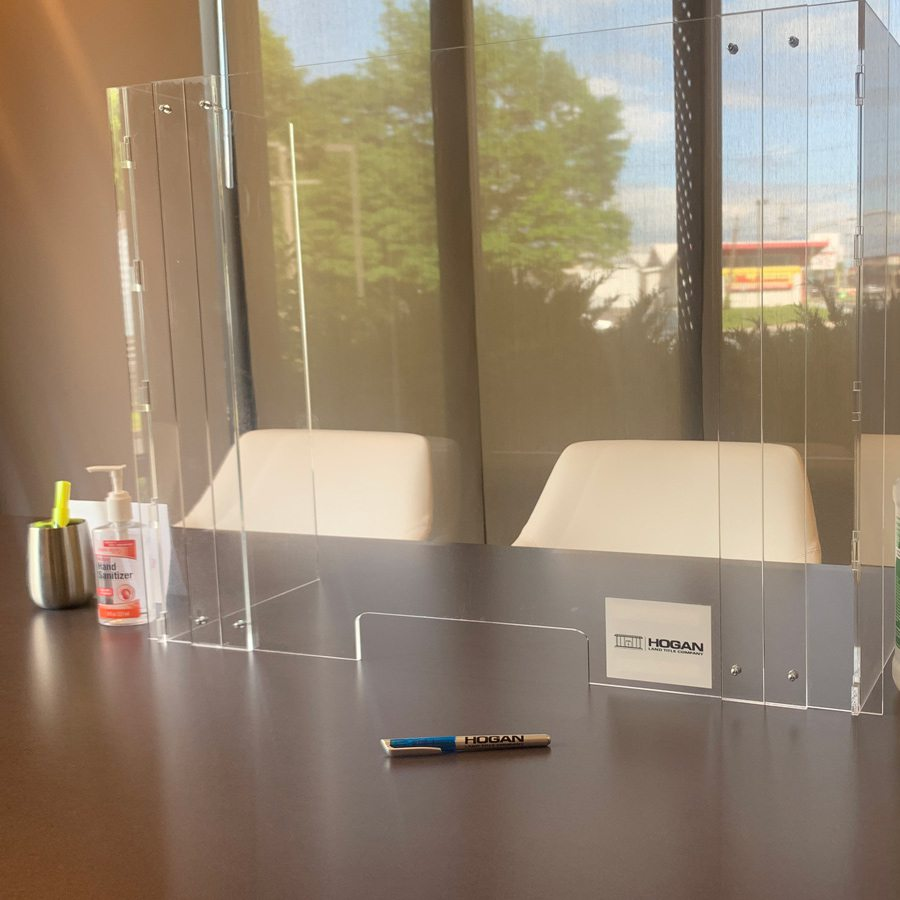 Plexiglass shield at office front desk made by BJ Trophy in Springfield MO