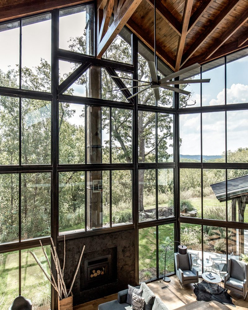 windows and fireplace inside of a home for sale