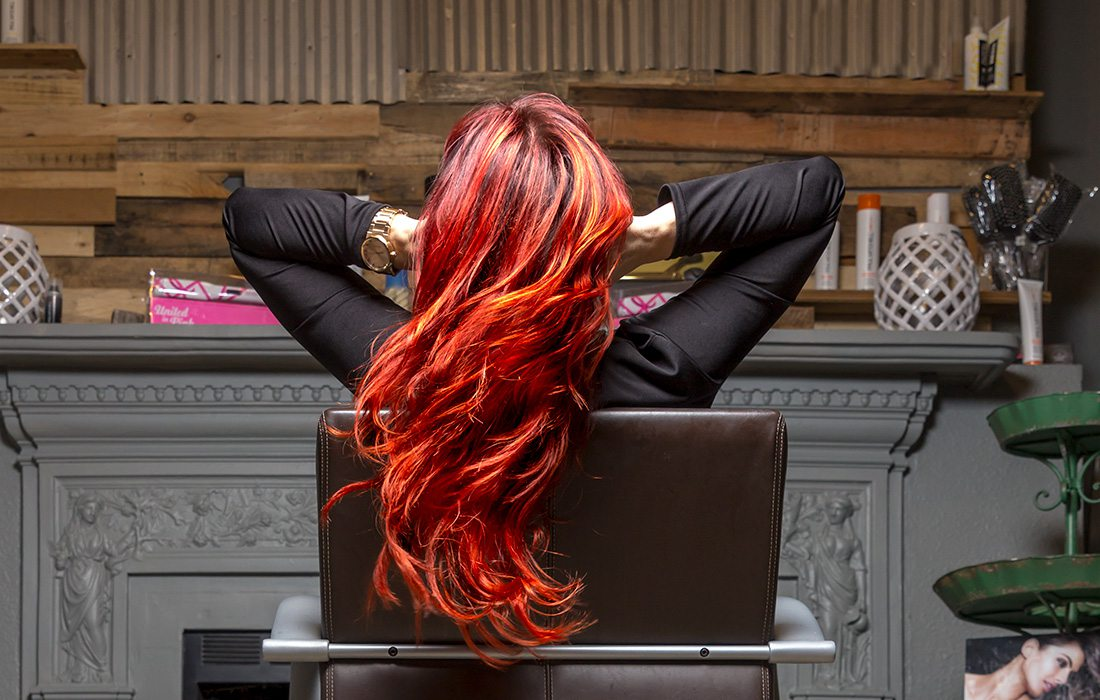 girl with red hair at a hair salon