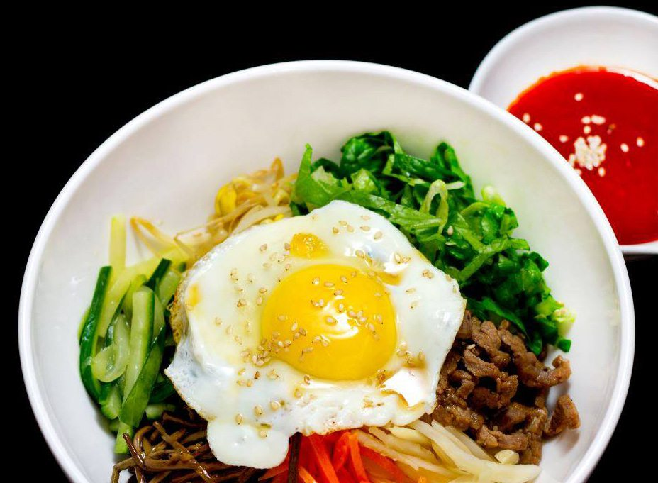 Bibimbap served with an egg sunny-side up.