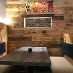 Slider Thumbnail: Restaurant booth with wood table