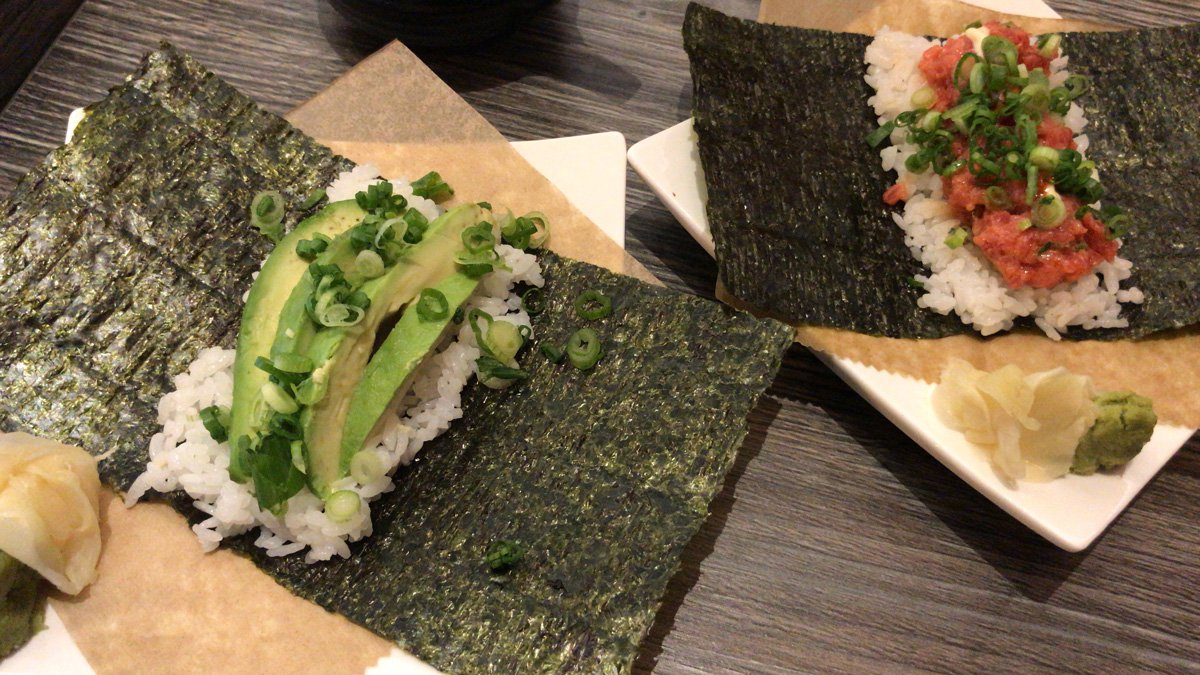 Hand-rolled sushi on seaweed with avocado
