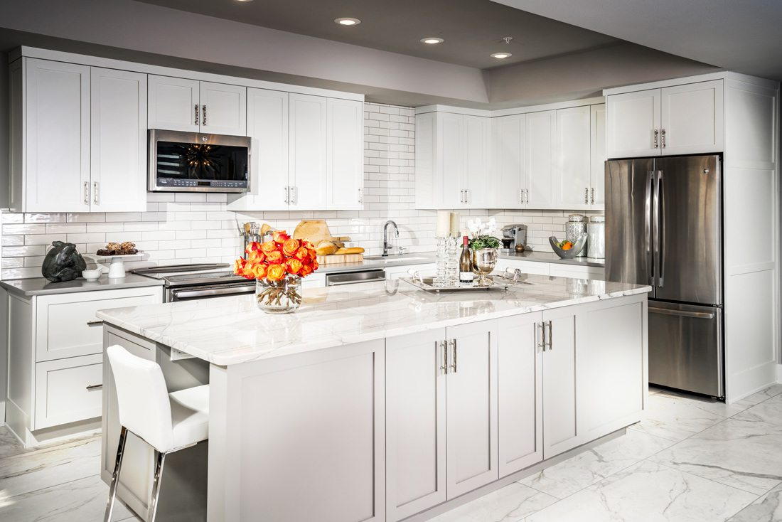 White kitchen countertop and cabinets.