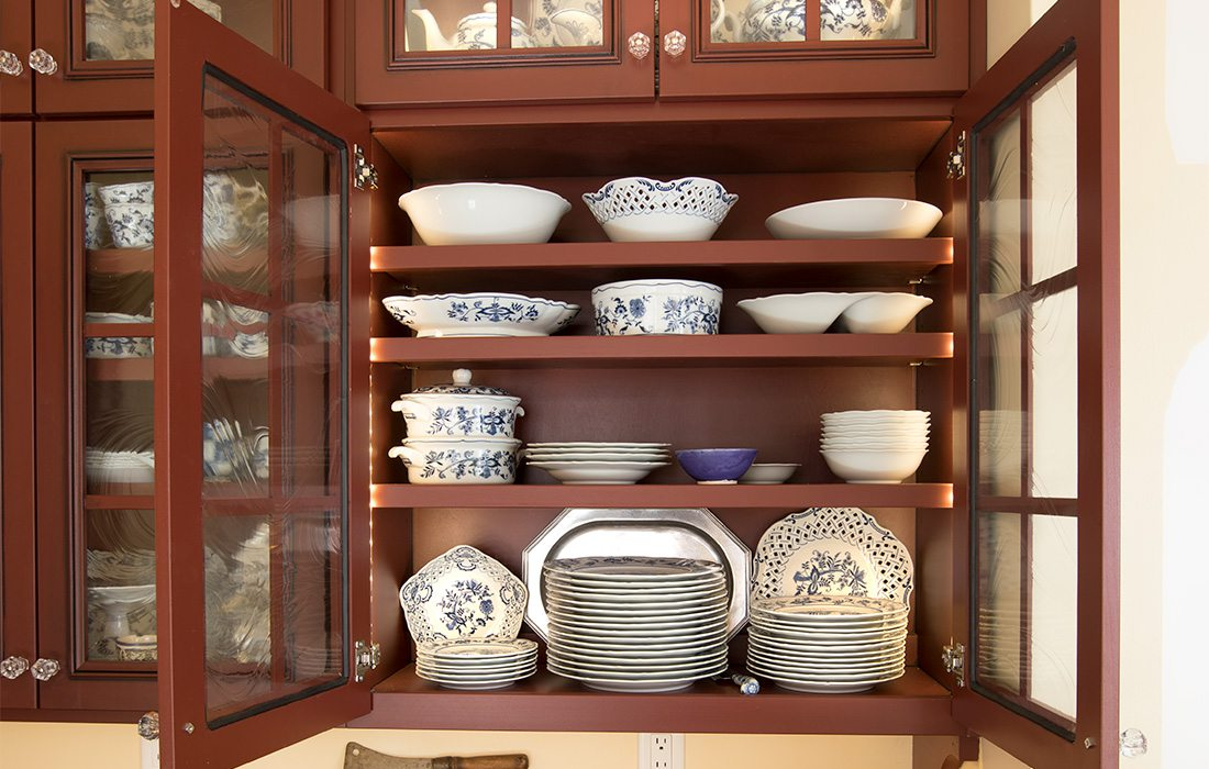 dishes in a wooden pantry
