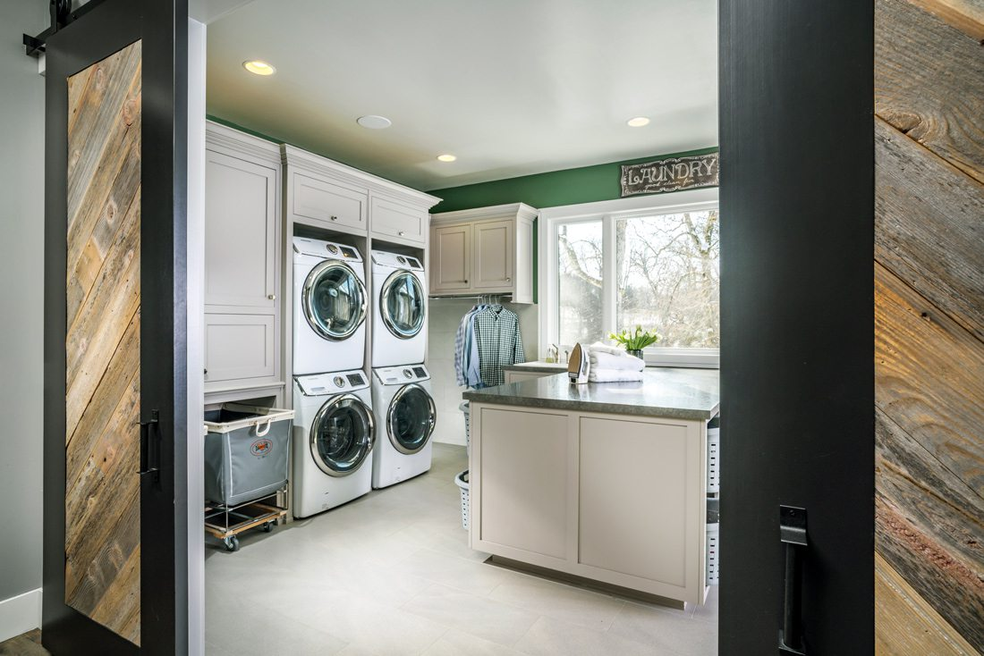 Big laundry room with island and laundry shoot.