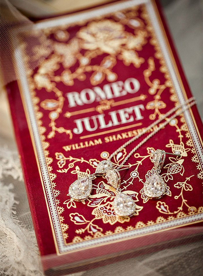 jewelry on top of a romeo and juliet book