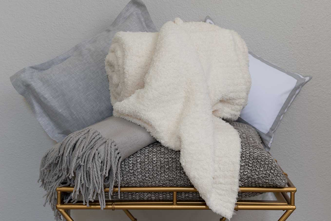 linen and pillows piled up