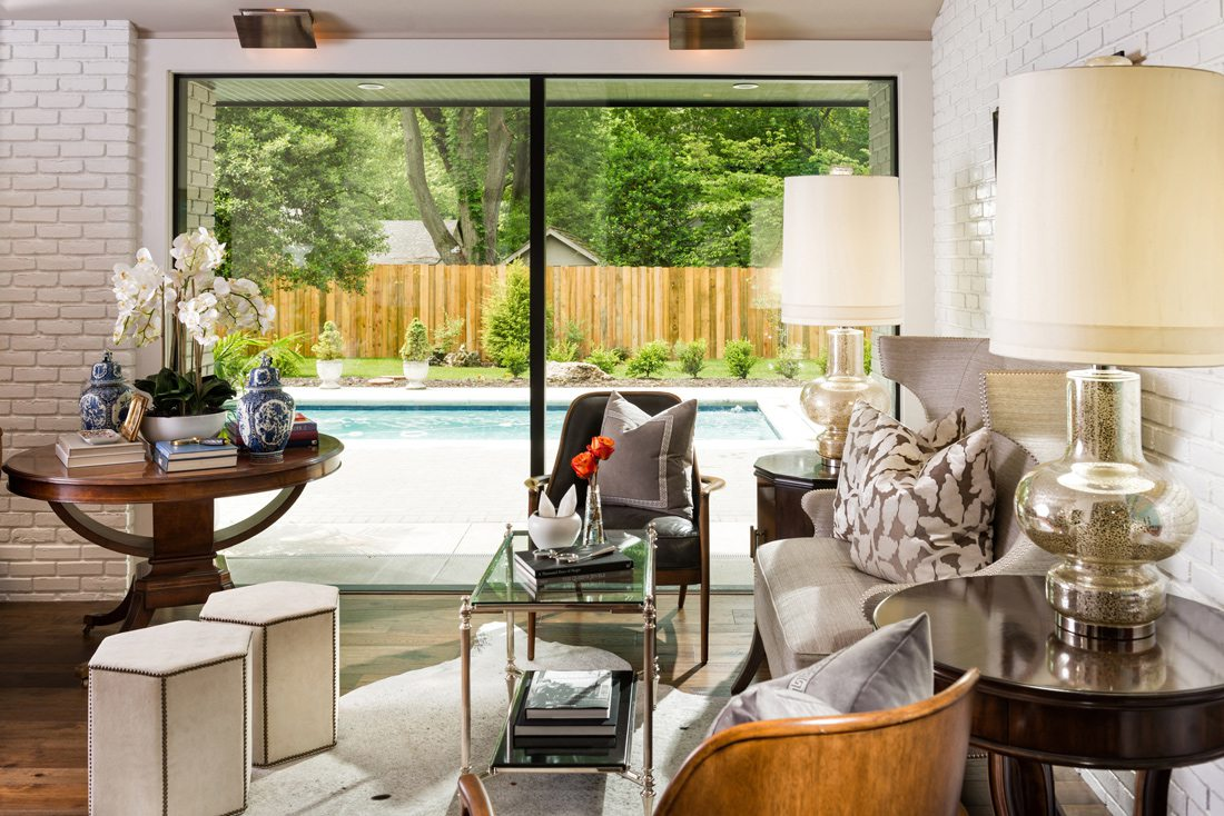 Bright seating area with pool view.