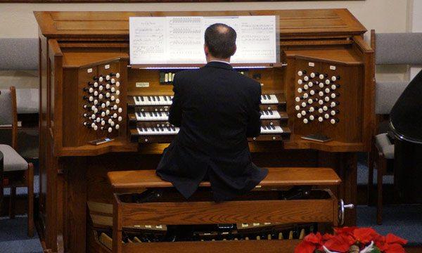 man playing organ