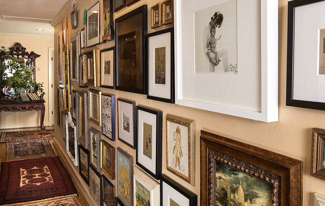art collection in hallway of a home