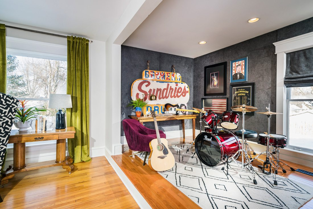 Music room with colorful furniture by Obelisk Home.