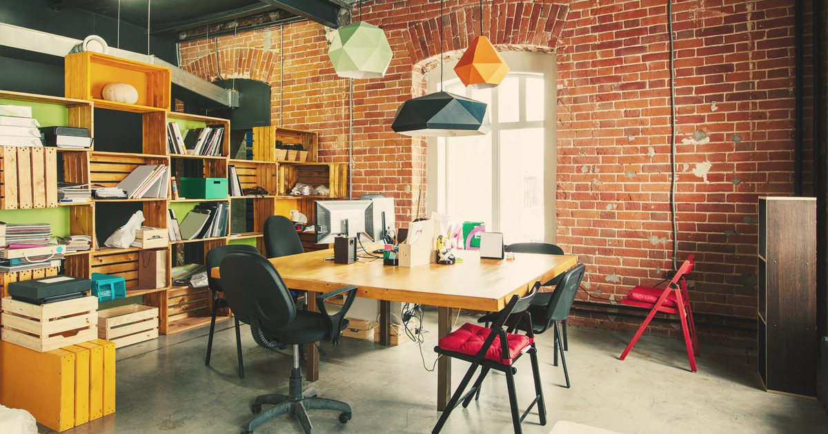 Modern office Interior with old vintage brick Wall. Art work business space.