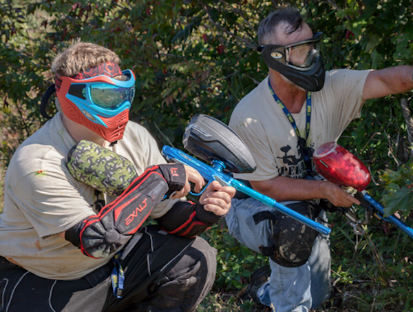 two people with paintball guns