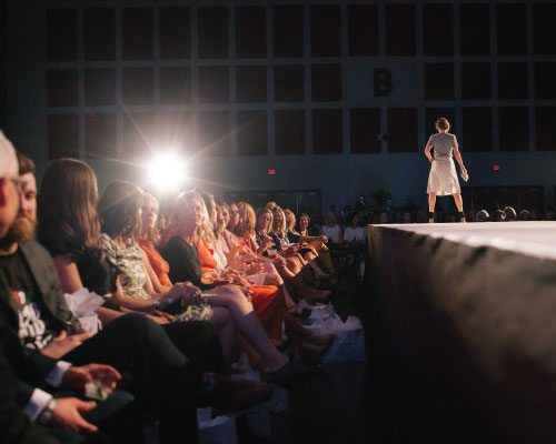 Woman on the runway at 417 Magazine's Fashionation