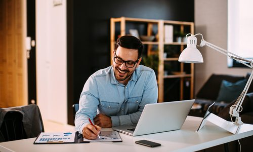 Man working remotely stock photo
