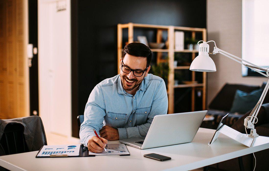 Man works on computer at desk