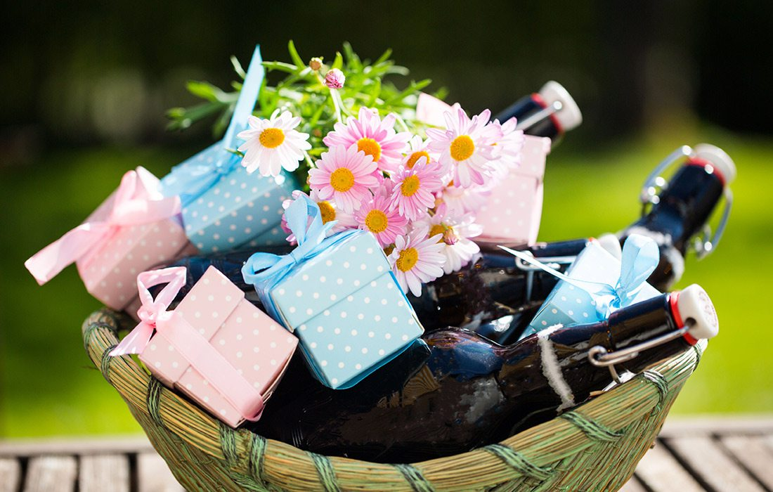 Gift basket with flowers and beer bottles