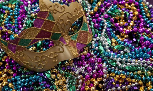 Mardi Gras mask and beads stock image.