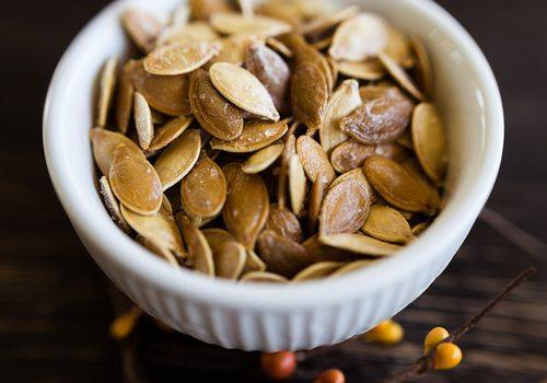 Roasted pumpkin seeds stock photo.
