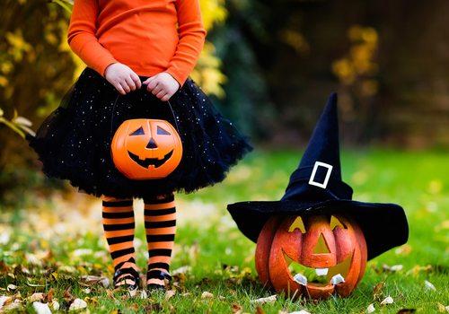 Girl holding Halloween candy bucket