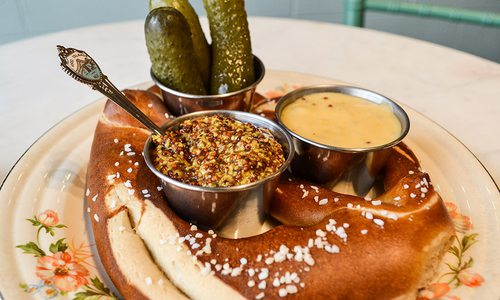 Soft pretzel with mustard at The Royal