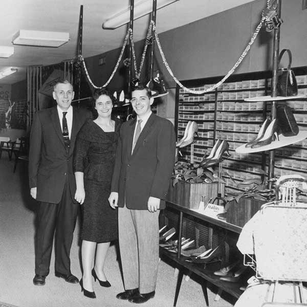 the original store owners smiling in the very beginnings of the store