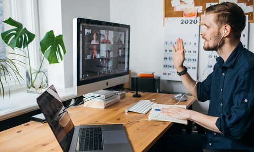 Man working remotely virtual meeting