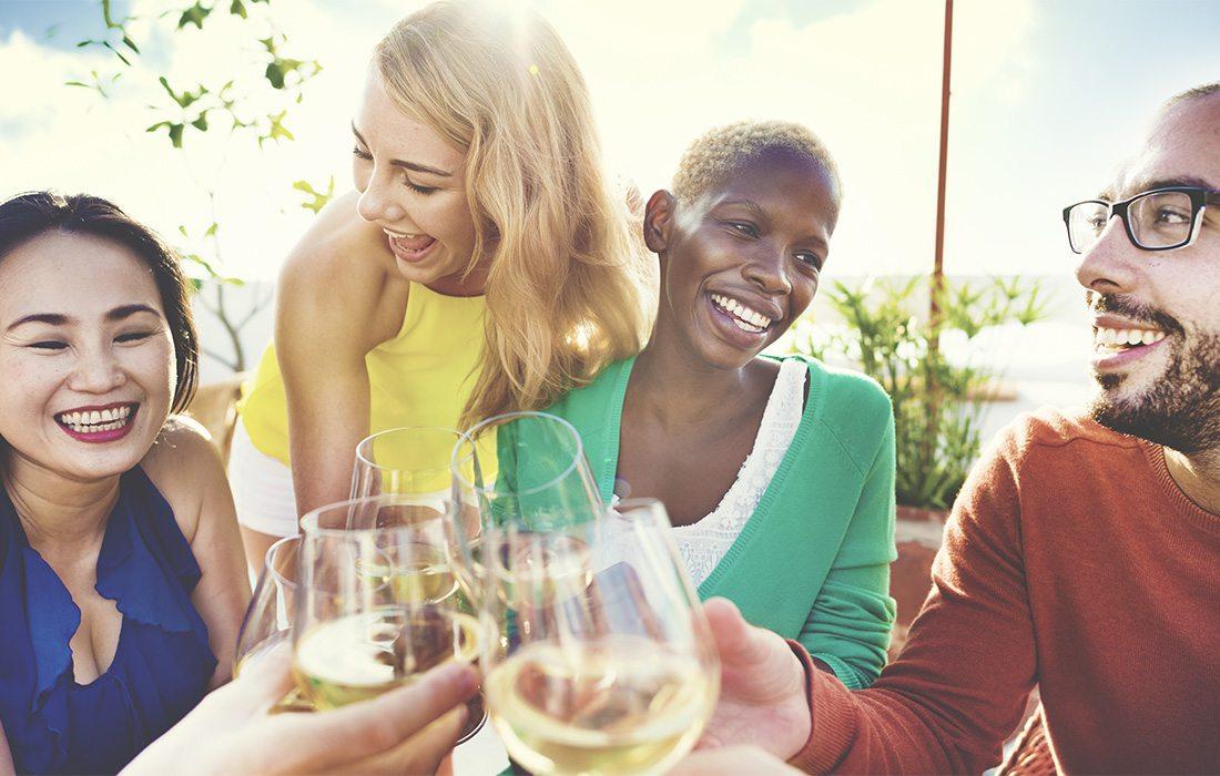 Friends enjoying a glass of wine.