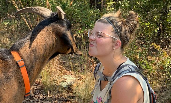 Woman with goat on 37 North Expeditions Hike